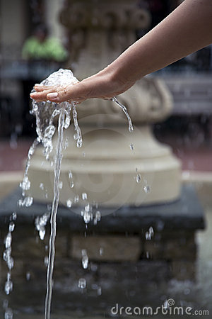 Refreshed hand at a water fountain