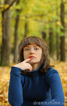 The girl reflecting in an autumn wood