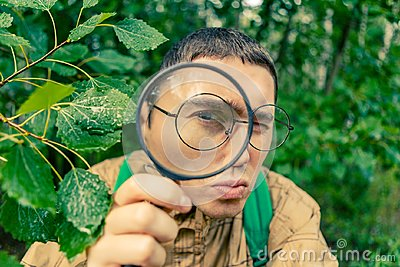 Portrait of male botanist with magnifying glass