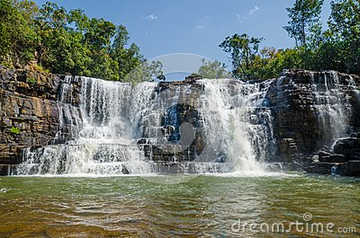 Beautiful Sala water falls near Labe with trees, green pool and a lot of water flow, Guinea Conakry, West Africa
