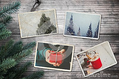 Photo album in remembrance and nostalgia in Christmas winter season on wood table.