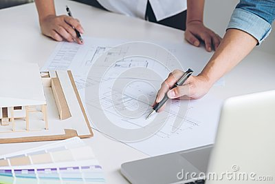 Architect working on blueprint, Engineer meeting working with pa