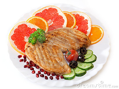 Chicken cutlets with a cucumber and a grapefruit