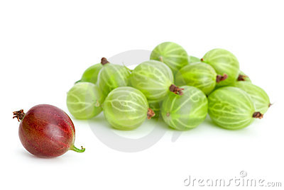 Pile of green gooseberries and one red alone