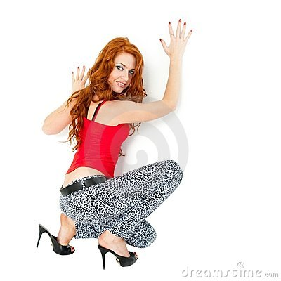 Woman sitting on a white background