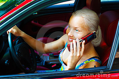 Attractive young woman calling by cellular phone