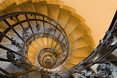 Spiral staircase and stone steps in old tower