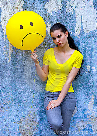 Teen girl with sad smiley balloon