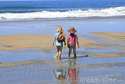 Сhildren are walking at the beach