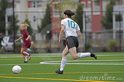Girls soccer player after the ball