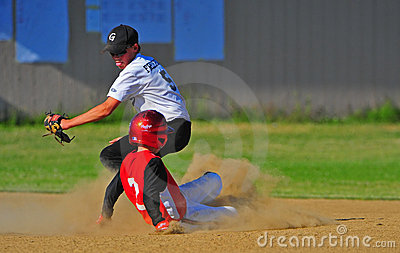 Baseball moving for the tag.