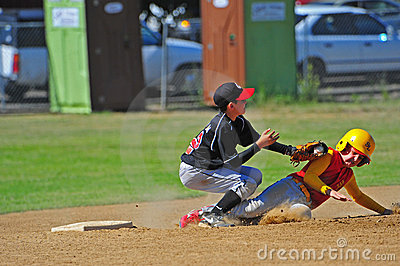 Baseball sliding into the tag.