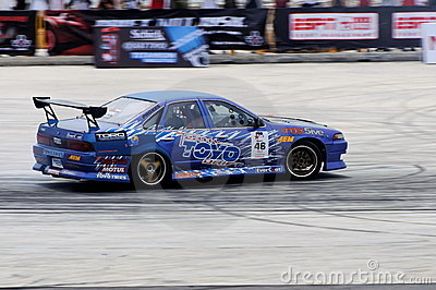 Nazrul performing a drift during a competition