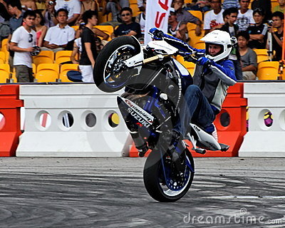 Mattie Griffin performing a wheelie with his bike