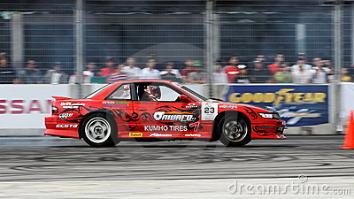 Wei drifting in his red coupe