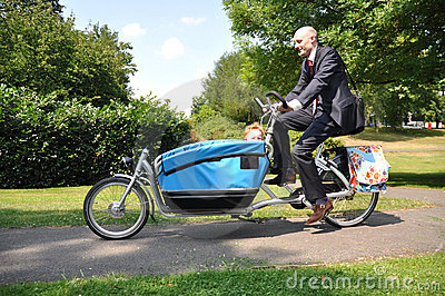 Business men riding his child to the creche