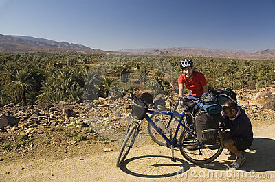 Man and woman cycling in south Morocco
