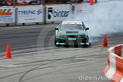 Green car drifting during Formula Drift Singapore
