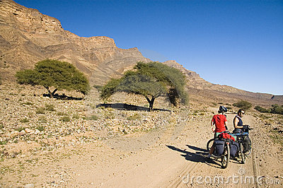 A couple resting during a cyclist tour in Morocco