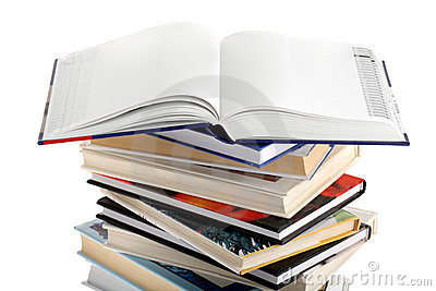 Open dictionary with blank pages on top of books
