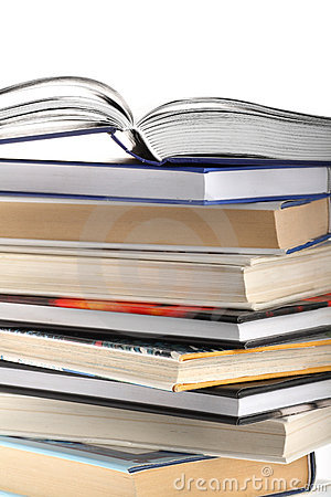 Open book on top of book stack isolated on white