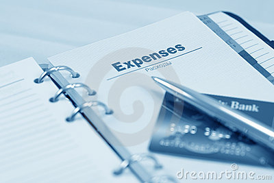 Opened organizer, pen and credit card