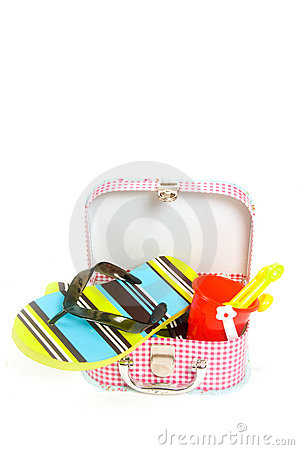 Small suitcase with sand toys and slippers