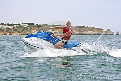 Young guy cruising on a jet ski