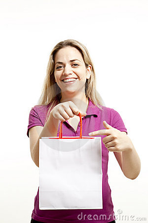 Young woman shows paper shoppings bag