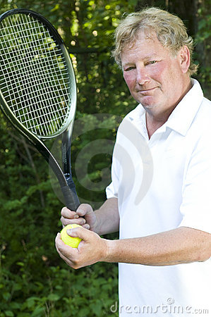 Middle age  tennis player demonstating stroke