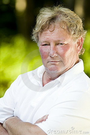 Serious middle age senior tennis player male