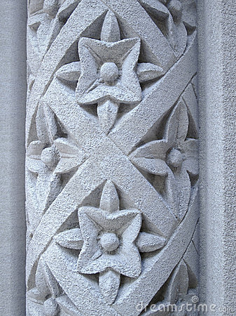 Floral pattern carved into a stone pillar