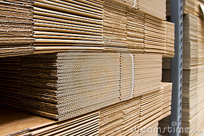 Shelves with packaging carboard close-up