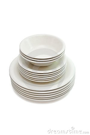 Stack beige dinner plates, soup plates and saucers