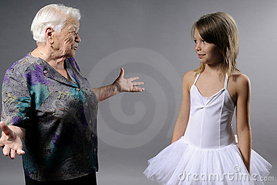 old woman communicating with girl