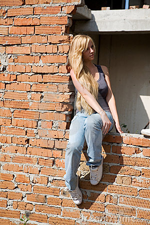Girl on brick wall