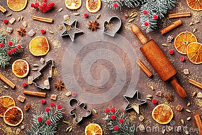 Holiday food background for baking gingerbread cookies with cutters, rolling pin and spices on table top view.Christmas recipe.