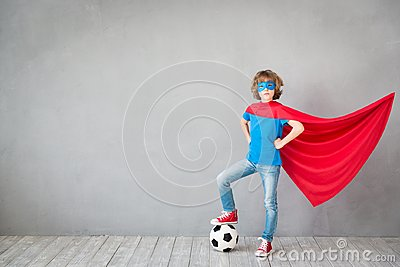 Child pretend to be soccer superhero