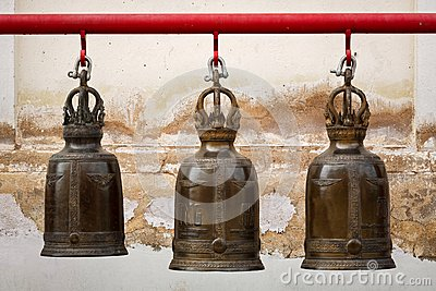 A row of three buddhism big bell in thai temple