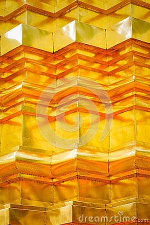 Pattern and texture of gold stucco technic on thai pagoda surface.