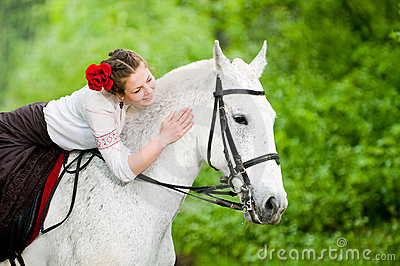 Beautiful girl riding horse