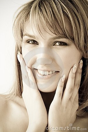 Fetching smile. Beautiful woman close up.
