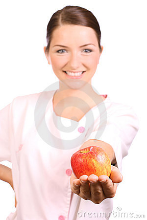 Nurse offering an apple