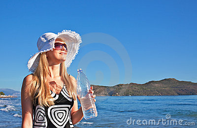 Young blond woman with bottle of water