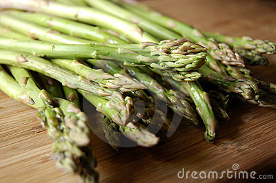 Asparagus on wooden cutting board