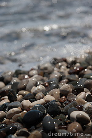 Wet pebbles on sea coast