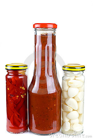 Jars with marinated piquant vegetables