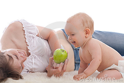 Mother give green apple to her son