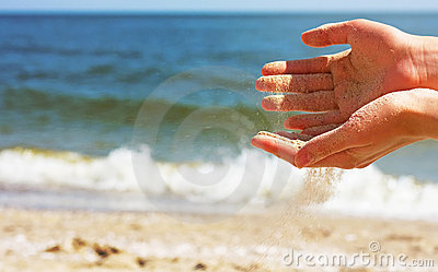 Hands playing with sand