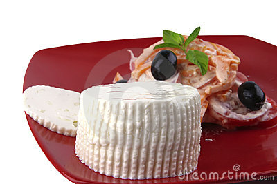 White cheese on red dish